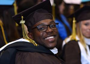 Graduate Smiles at Camera